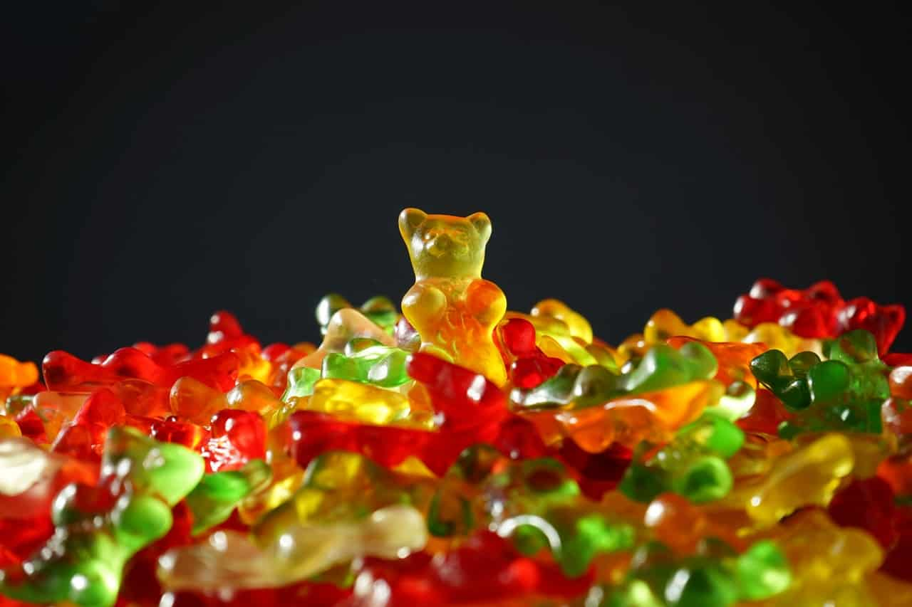 A pile of different colored gummy bear candy.