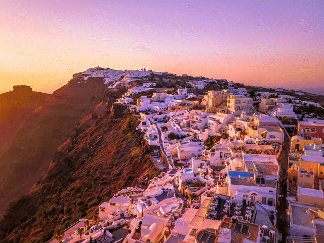 A picture of a hill with houses and apartments