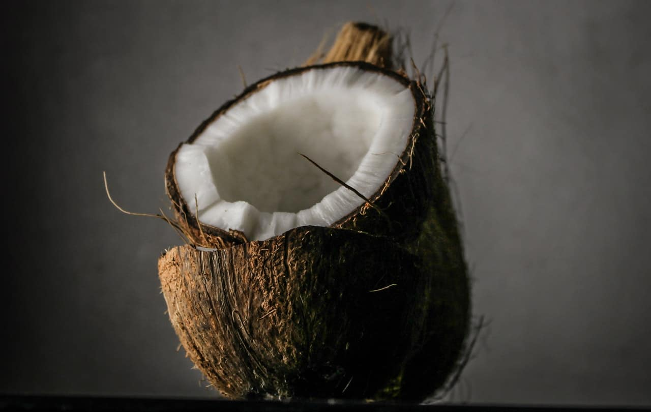 A coconut sliced in half