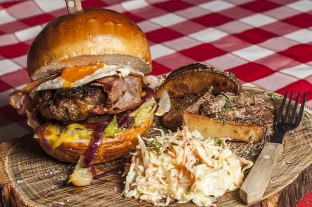 A burger plate on a picnic table