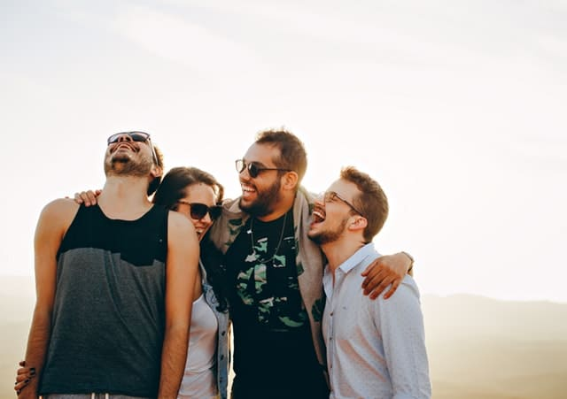 Four people laughing together